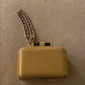 C wonder gold clutch